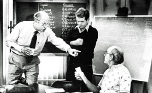 Stu Inman (left) offers up a little NBA Draft perspective in the war room with assistant coach Jimmy Lynam (middle) and head coach Dr. Jack Ramsay (right).
